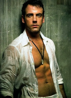 Carlos Ponce. His voice is just as hot as those abs!