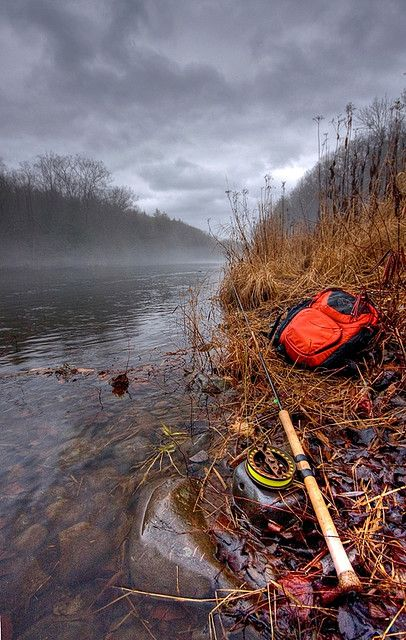 love this photo. I love the orange pack against the grey sky, as the seasons are changing, and i love the mist above the river.  It has a cold feeling, only because of the weather. I really like this one