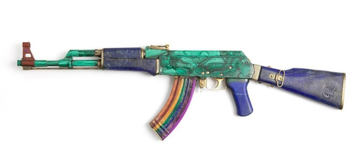"""""""I wanted to remove the gun's main function which is to shoot and kill and make it out of stone as if the gun had been petrified. The rainbow magazine shoots rainbows rather than bullets. The Rainbow is a universal symbol of peace and tranquillity."""" Solange Azagury-Partridge tranforms a wood + metal AK-47 rifle with lapis and malachite for AKA Peace http://peaceoneday.org/aka-peace/"""