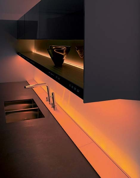 Lumilum rgb led strip lights set to orange energy saving led lights can provide a welcoming glow under kitchen cabinets