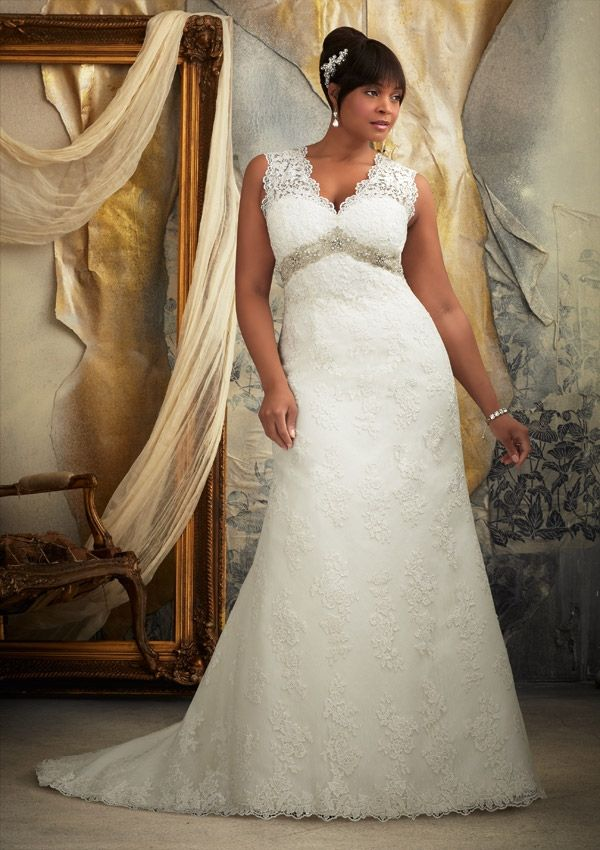 Venice Lace Appliques on Net Trimmed with Beaded Embroidery Plus Size Wedding Dress. Colors available: White/Silver and Ivory/Silver.Designed by Madeline Gardner.