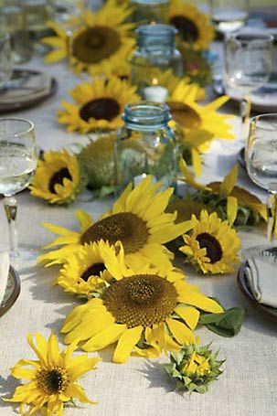 Sunflower and Ball jar centerpiece. Good idea laying them flat....they are hard to arrange in a vase
