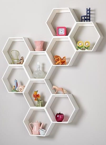 When designing these shelves, we thought it was a great idea to make them a unique shape that can be oriented in any direction. We thought it was a bad idea to include a complimentary bee colony.