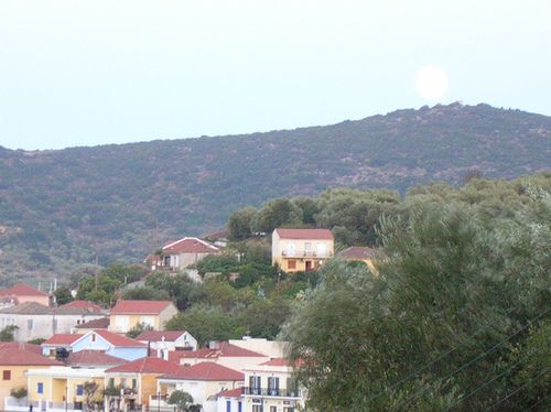 Pale shades... over the houses of Vathy, Ithaca, Greece