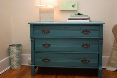 blue dresser to set the tv on and hide the game consoles and remotes in