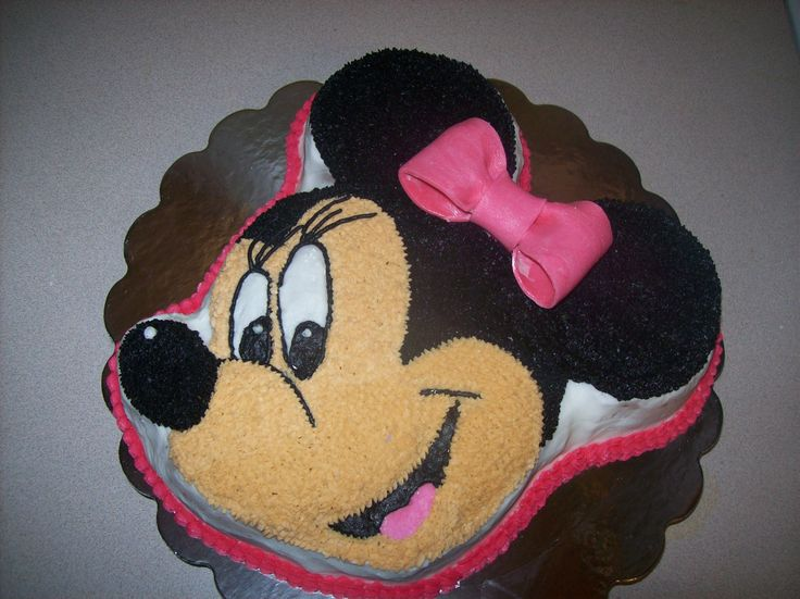 Minnie Mouse Cake - Cake made using the Wilton Mickey Mouse cake pan.  Added eyelashes and bow to make it a Minnie Mouse.  All done in buttercream with fondant bow.