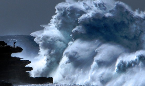 A massive wave explodes on Ben Buckler point at North Bondi on a particularly big day a few years ago. This nutbar jumped the security fence for a couple of happy snaps (and lived). Totally worth it, awesome photo.  Photo credit: Bob Barker