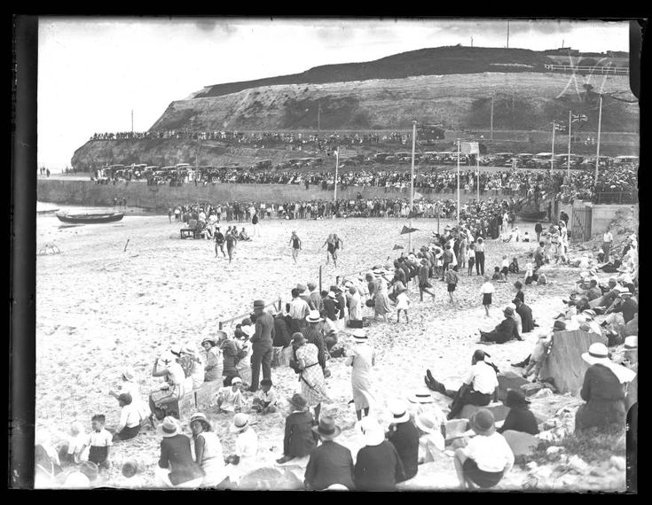Crowd gathered at the beach, c.1930's. This photograph was scanned from a glass or film negative in the archives of The Newcastle Sun newspaper which are held by Cultural Collections at the University of Newcastle, Australia.
