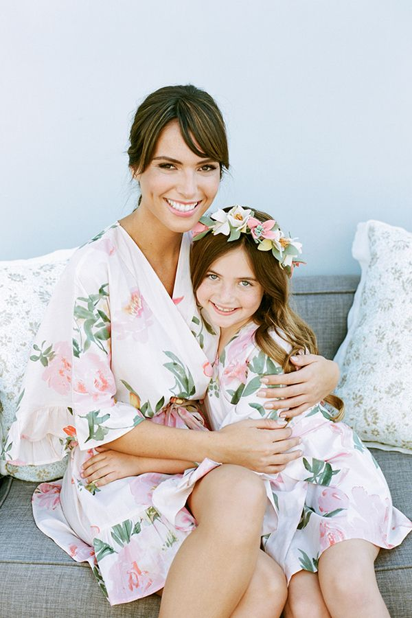 Delicate floral prints upon matching robes are