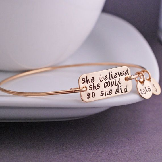 "Each bangle is hand formed from sterling silver wire and then hand-hammered and tumbled for shine and strength. A stainless steel rectangle measuring 1 inch across is engraved with the words ""she beli"