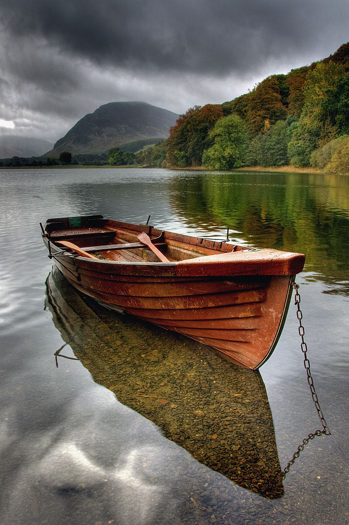 Autumn on Buttermere in the English Lake District - Phil Jones, UK photography {row boat beneath stormy clouds}