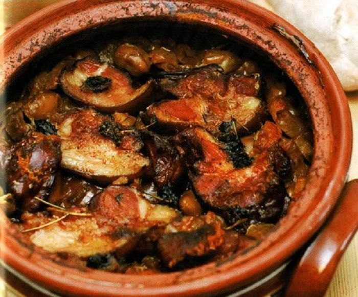 Eggplant with mushrooms in a pot