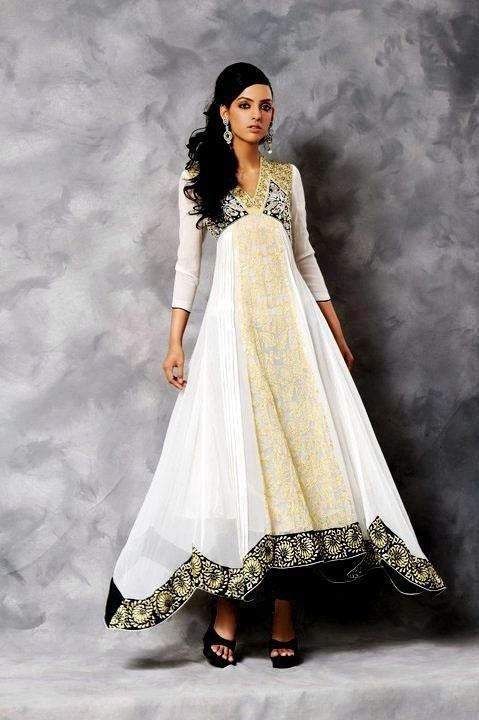 Stunning and uniquely shaped black, white and gold anarkali.
