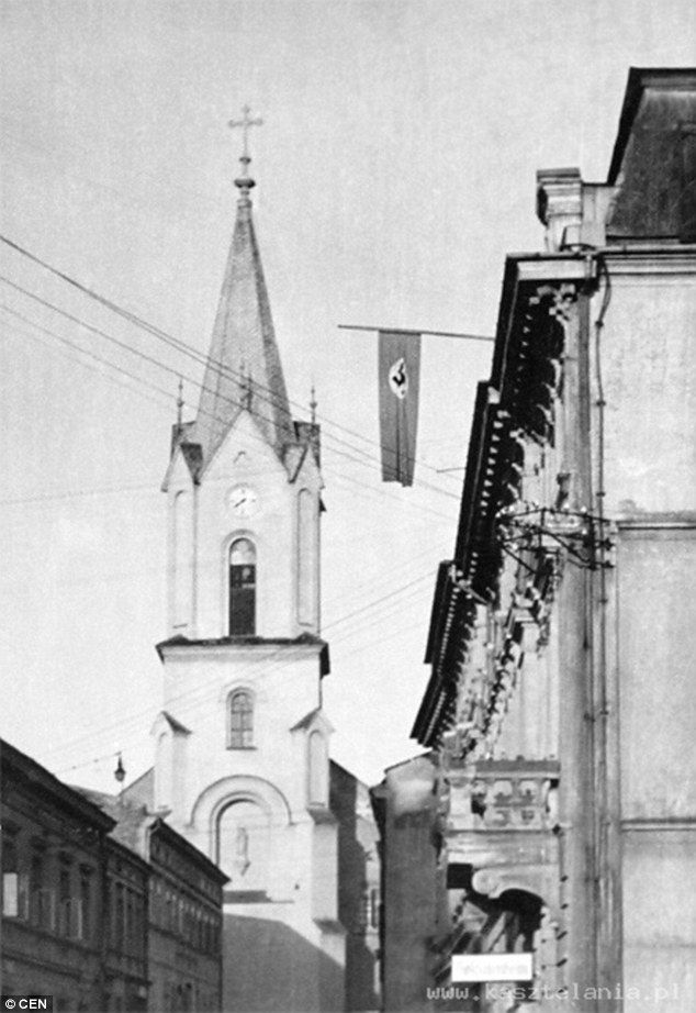 Control: Nazi flags used to adorn the buildings ofOswiecim, reminding residents they were...