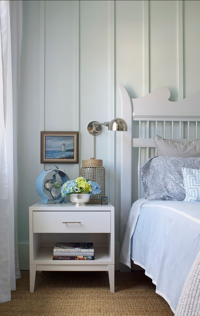 This is a very relaxing bedroom. Small yet comfortable.   Night stand is by West Elm and the sconces are by Ralph Lauren.