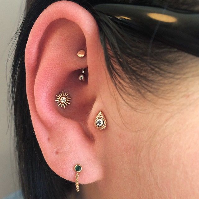 """""""Yesterday I had the pleasure of doing this beautiful trio: A rook, conch and tragus piercing with matching 14g gold jewelry from BVLA."""" Courtney Jane Maxwell, Saint Sabrina's in Minneapolis, MN"""
