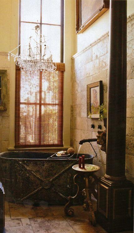 Decorator Gwynn Griffith's Converted San Antonio Factory, Texas    A zinc bathtub and a tumbled-travertine floor in the guest bath; a marble platter atop an Italian base serves as a table.