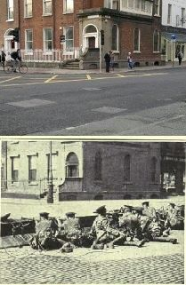 Taken from the junction of Lr Merrion St & Merrion square. The troops have their guns pointed in the direction of what is now Govt Buildings. Both photographs illustrate how little has really changed in the area.