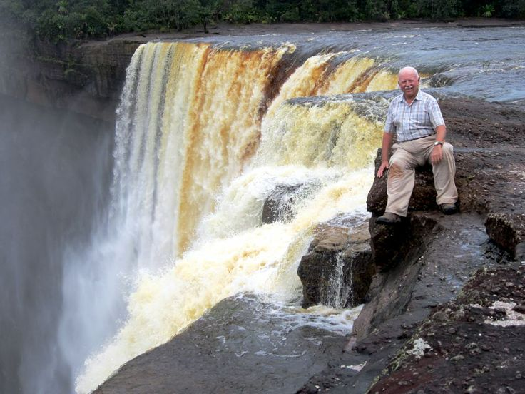David Stanley perched on a sandstone outcrop at Kaieteur Falls in central Guyana.