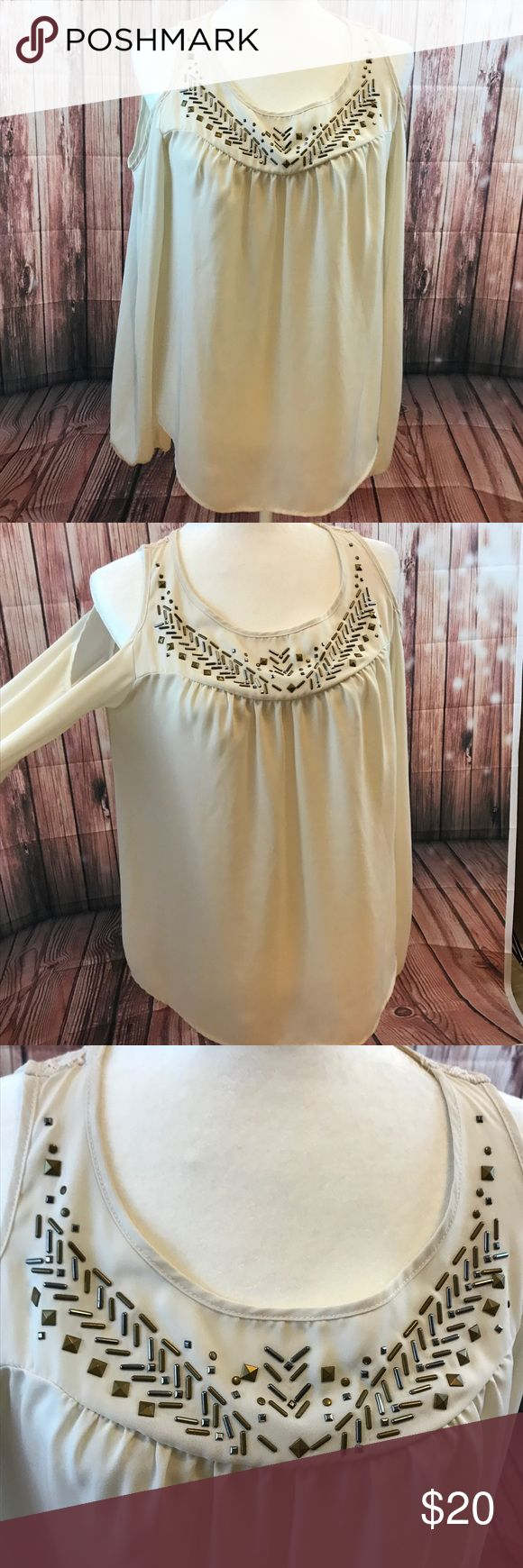 Xhileration Lg cold shoulder sheer lace aztec top Xhileration tan/ cream sheer cold shoulder long sleeve top with aztec style beading on top of front and lace on top of back. Xhilaration Tops