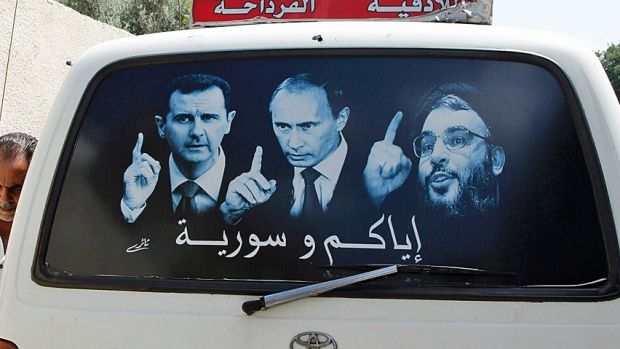 Assad, Putin and Hezbollah's Nasrallah on a bus ad in Syria for last years…