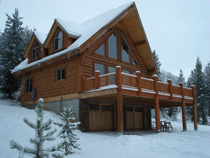 Stacked log cabin. 8 x 8 O logs.  Fox Hollow floor plan with garage option down below & great room w/view.