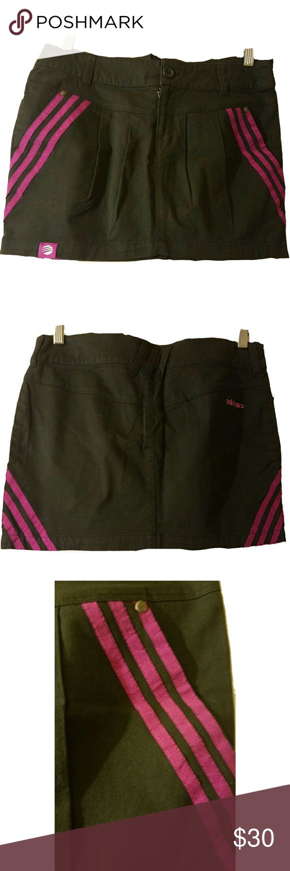 adidas Neo Mini Skirt, M Black mini skirt with purple-pink stripes, slight pleats in front for a tulip cut, zipper and button front closure, 2 slant front pockets, belt loops. Excellent condition.  Measurements: waist (32 in), hips (37 in), length (13 in) Adidas Skirts Mini