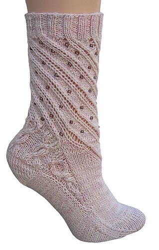 Miss Margaret Socks. The heel on this is my favorite part. That and the way the knit ribbing drizzles into the spiraling stitches. Also, the decorated arch detail is in full force here. Must get away from knitting all sample socks in pink. Hand knit sock pattern by Katie Franceschi
