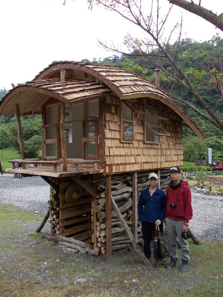 Tiny house on stilts with a curved roof tiny houses for Tiny house on stilts