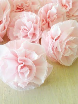 Crepe Paper flowers... I think I would put these on lollipop sticks and use for cake/cupcake decorations?  Looks fun!!