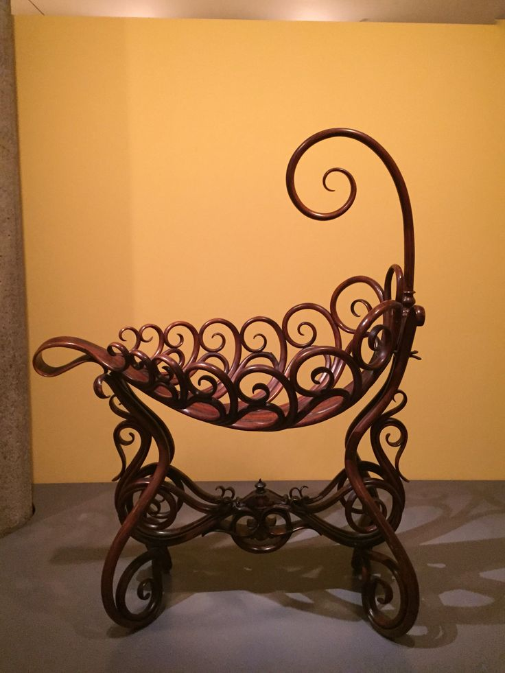 Baby cradle (1878) - designed by J. And J. Kohn manufacturer - located in Vienna, Austria - made from beechwood - used steam-bending technique