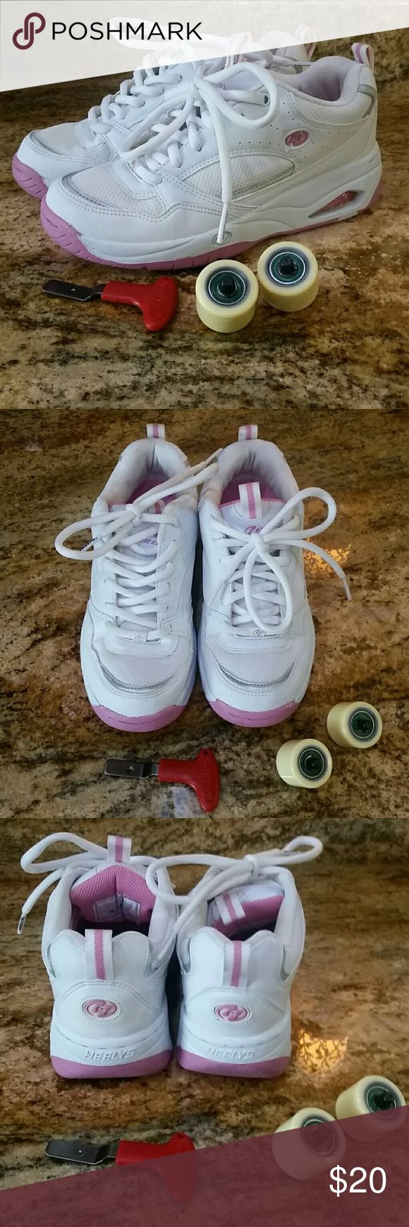 EUC Heely's White / Pink Shoes Heely's White / Pink Shoes, comes with wheels and tool. Only worn a handful of times, EUC and very clean. No scuffs or wear. Sorry, no box. Heelys Shoes Sneakers