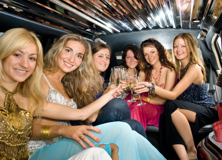 Group of beautiful women. Clinking glasses with champagne inside a limousine , #…