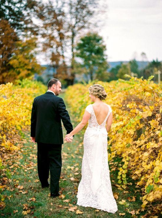 Bride and groom strolling through the autumn vines // Finch Photo #fallwedding #southernwedding #weddingvenue #castletonfarms