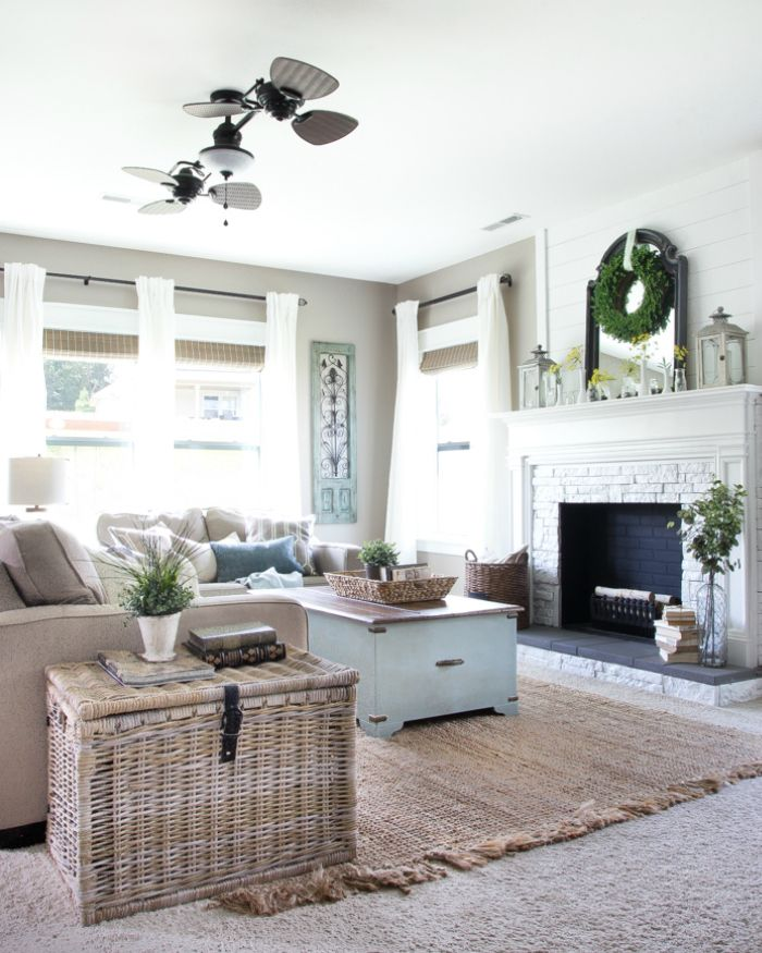 The Best Way to Make a Big Statement With Window Decor   blesserhouse.com - A living room gets a window decor makeover with DIY Craftsman window trim, long white curtains, and natural woven shades from Blinds.com #sponsored