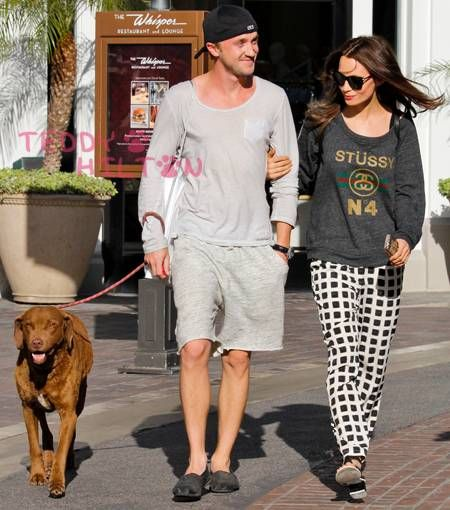Tom Felton and Jade Olivia walk their dog through the Grove!