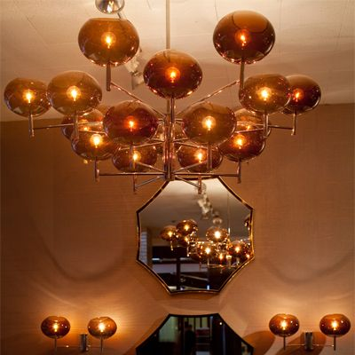 Renaldo Chandelier by Donghia  This Amazing #Chandelier by #Donghia casts a soft glow in our #Black and White room while adding a pop of color