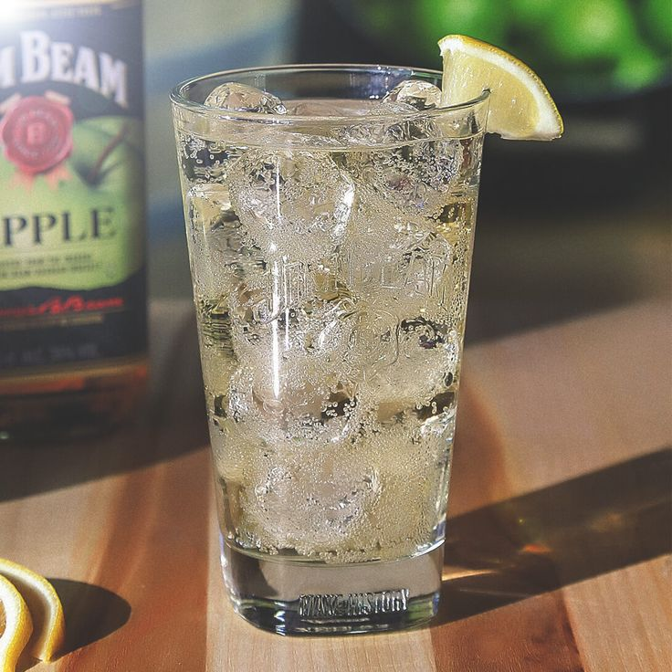 Jim Beam® Apple & Soda | Ingredients: 1 part Jim Beam® Apple, Apple Liqueur with Bourbon; 2 parts Club Soda; Lemon Wedge. Build over ice in a tall highball glass. Garnish with a lemon wedge.