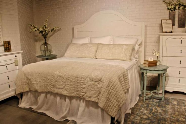This is a copy of the bed Chip and Joanne Gaines share at their Waco, Texas ranch. It is part of the Farmhouse group of Joanna Gaine's new signature furniture line, Magnolia Home. The dressers are from the French Inspired group. (Patricia Sheridan/Pittsburgh Post-Gazette/TNS) Photo: Patricia Sheridan, McClatchy-Tribune News Service / Pittsburgh Post-Gazette