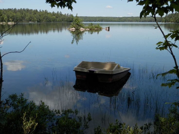 An abandoned paddle boat on Joeperry Lake in Bon Echo Provincial Park Ontario.