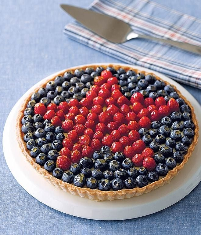 Fill a tart shell with a rich pastry cream and arrange fresh berries on the top in a star shape for a dessert that's perfect for 4th of July.