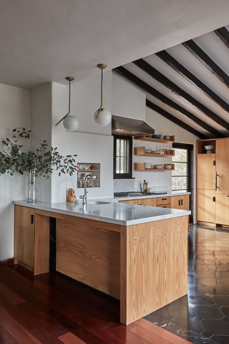 Currently admiring: a kitchen remodel in the Los Feliz hills. The 1920s Spanish-style house is owned by a newly married young couple—both professional crea