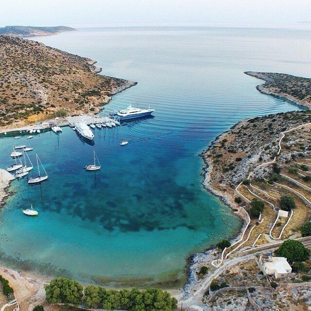 Amazing port of Schinoussa island (Σχοινούσα) . A very tiny island part of the small Cyclades islands with a very relaxing atmosphere and unique landscapes to discover .