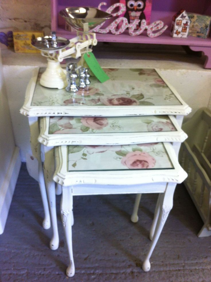 Queen Anne glass topped nest of tables.  Painted cream and distressed with vintage floral style paper inserts