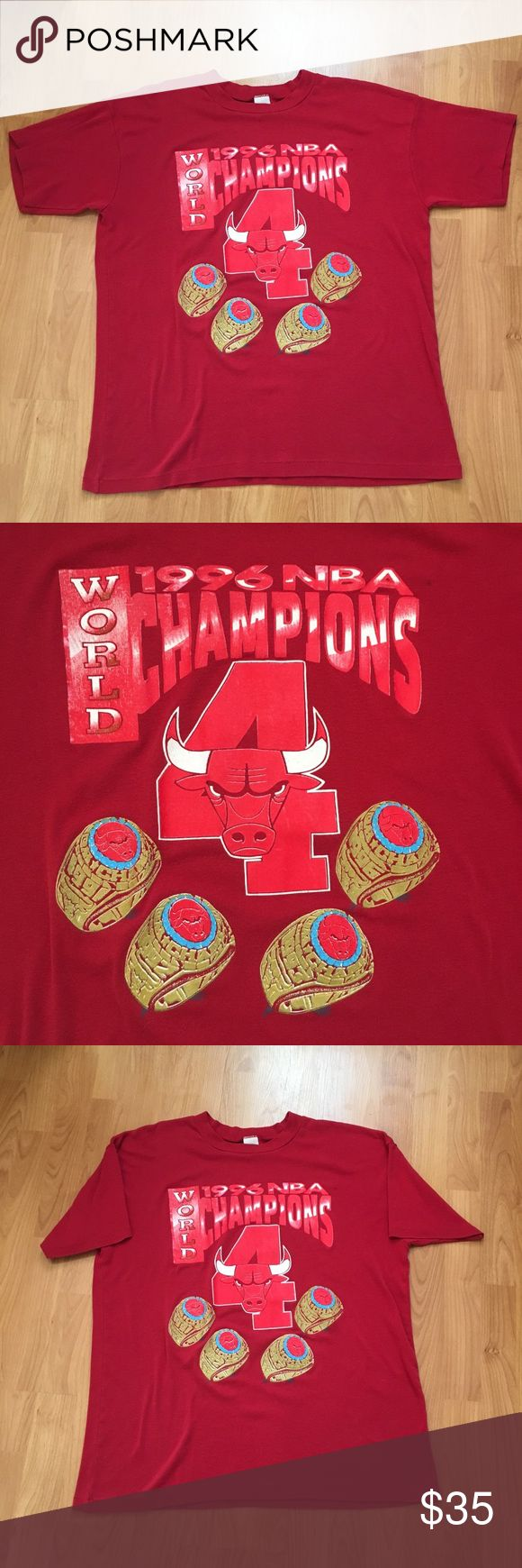Vtg Chicago Bulls 1996 NBA Champions T-Shirt Vintage Chicago Bulls 1996 NBA World Champions       T-shirt. Rad image of the Bulls Champion ship rings. The image and wording is raised. Tag is cut out and thus missing. Measurements below. One spot on front of shirt as shown in last photo.  Armpit to Armpit: 24 inches  Length: 29.5 inches Shirts Tees - Short Sleeve