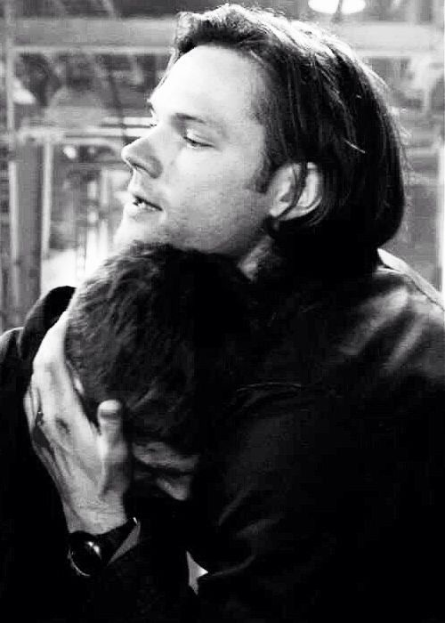I find it absolutely heartbreaking that Sam, the little brother, is cradling Dean's face in his hands and resting his head below his chin. Almost imitating the way an adult might cradle a young, upset, vulnerable child. Heartbreaking.