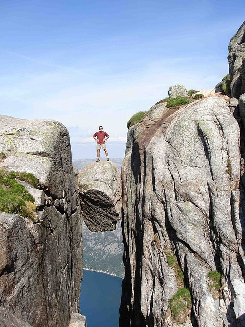 Kjeragbolten, Norway. I would like to see this, but standing on top