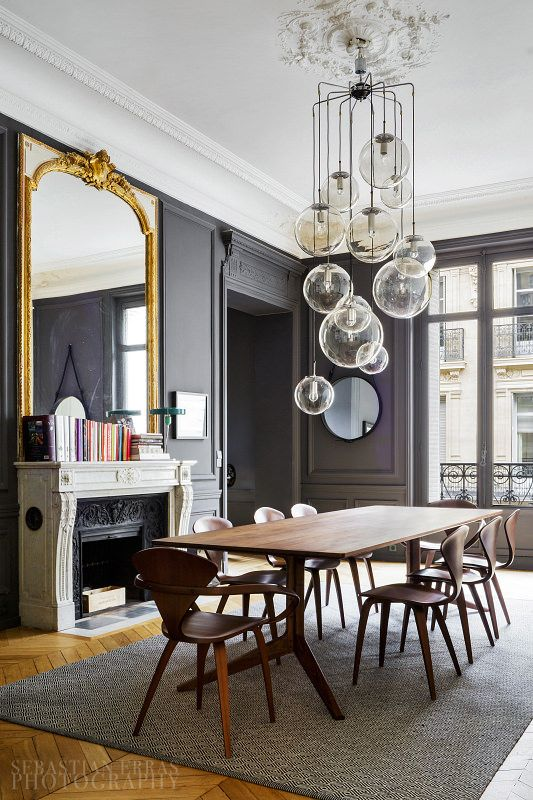 Grey dining room with the most stunning glass lights. The antique mirror above the period marble fireplace reflects the light from the floor to ceiling windows. The perfect mix of period and contemporary decor.
