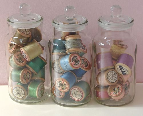 Vintage spools of thread, I would put them in vintage jars, for my sewing/craft room of course.