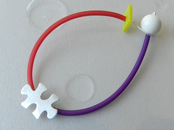 Puzzle bracelet silver coral rubber: Puzzle jewelry and a modern gift option!